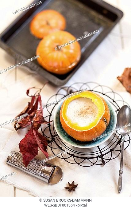 Oven baked mini-pumpkin filled with spiced hot coconut cream