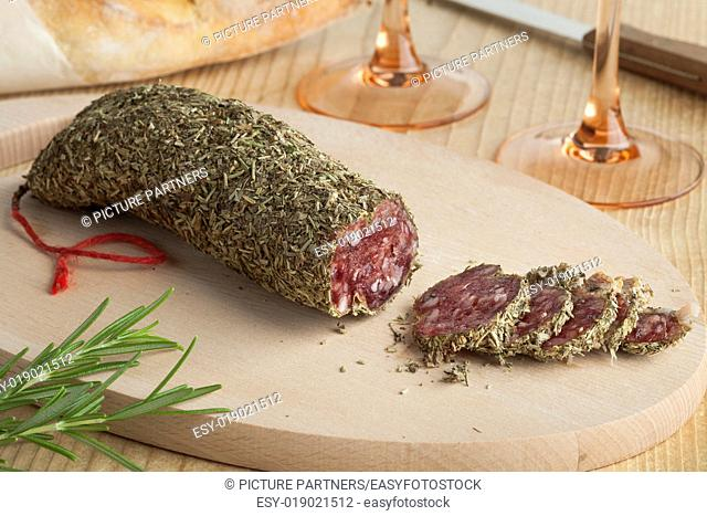 French sausage covered with dried rosemary
