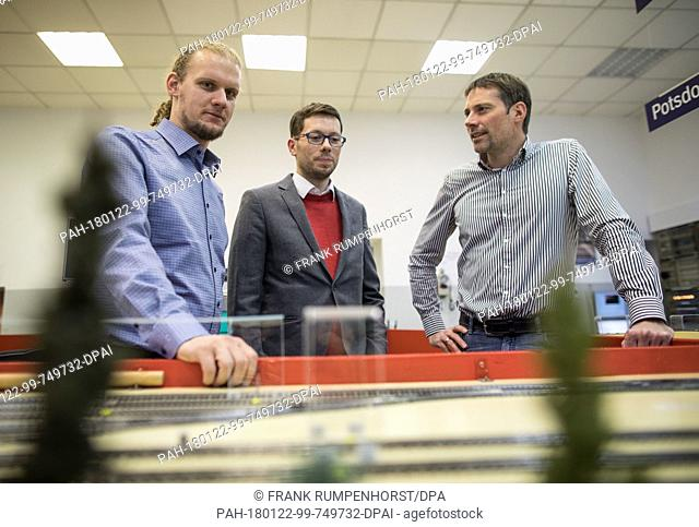 Christian Schlehuber (L-R), an expert on cyber security of the Deutsche Bahn Network, Markus Heinrich, a research assistant of the Technical University of...