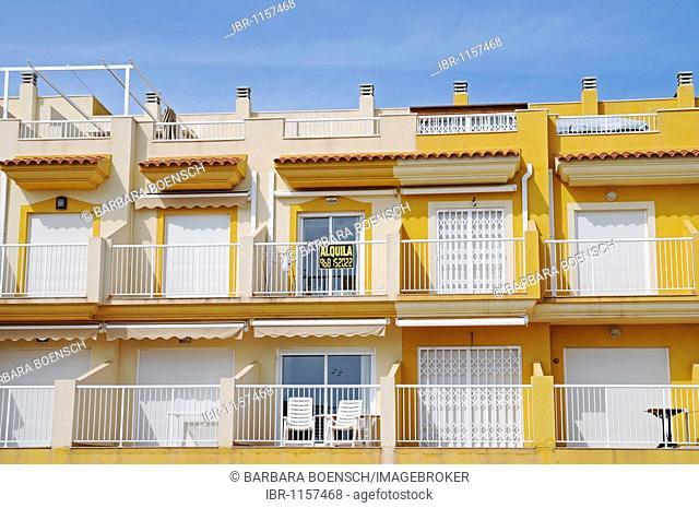 For rent, town houses, balconies, yellow, empty, chairs, Isla Plana, Puerto de Mazzaron, Costa Calida, Murcia, Spain, Europe