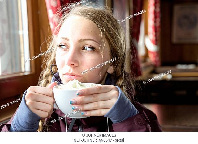 Young woman having hot chocolate