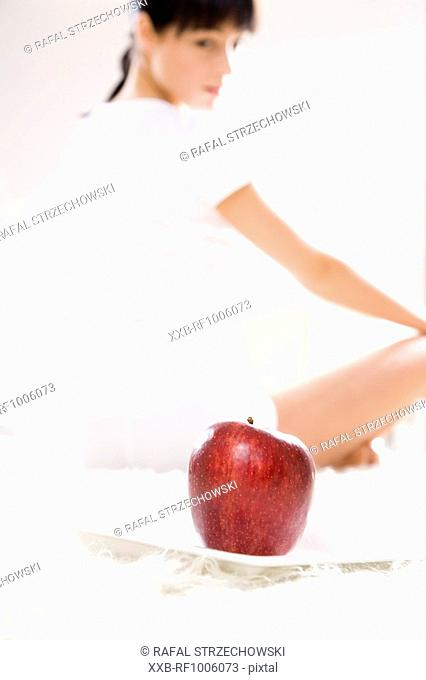 woman with apple on plate