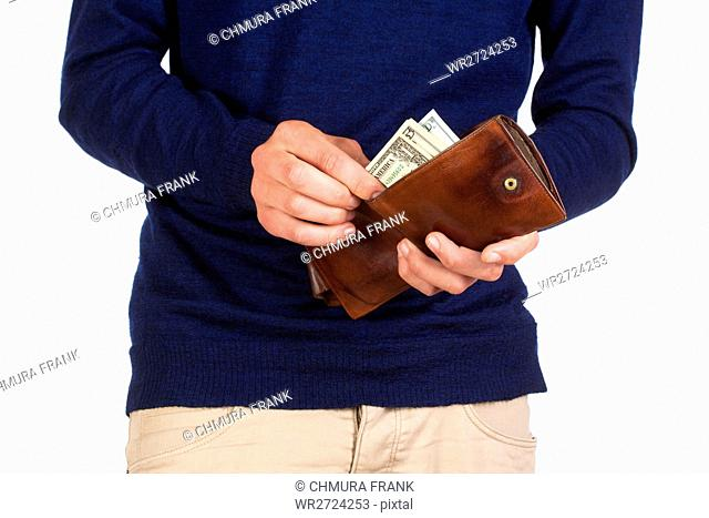 Man Holding a Wallet and Counting Dollars