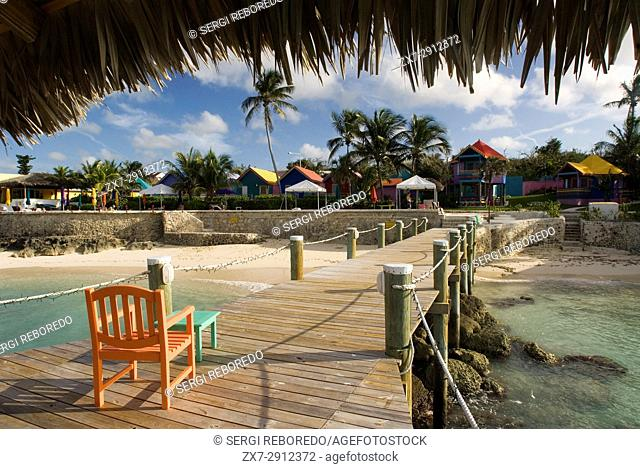 Wooden pier at Hotel Compass Point Resort at Love beach Nassau, Bahamas, Caribbean. Brightly Colored Cottages At Compass Point Beach Club