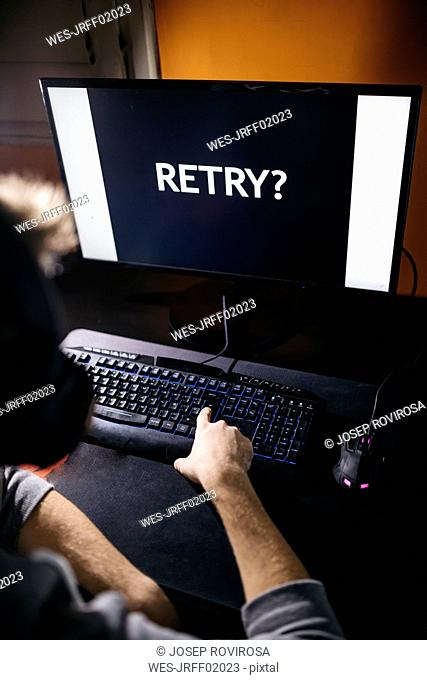 Young gamer resuming lost computer game