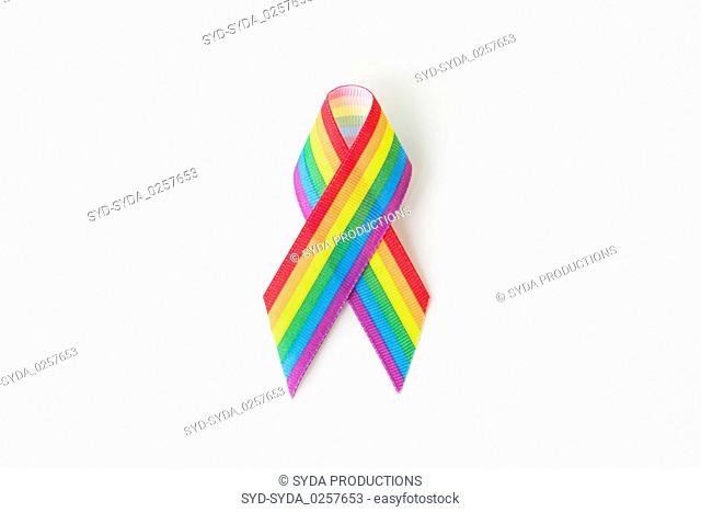 close up of gay pride awareness ribbon on white