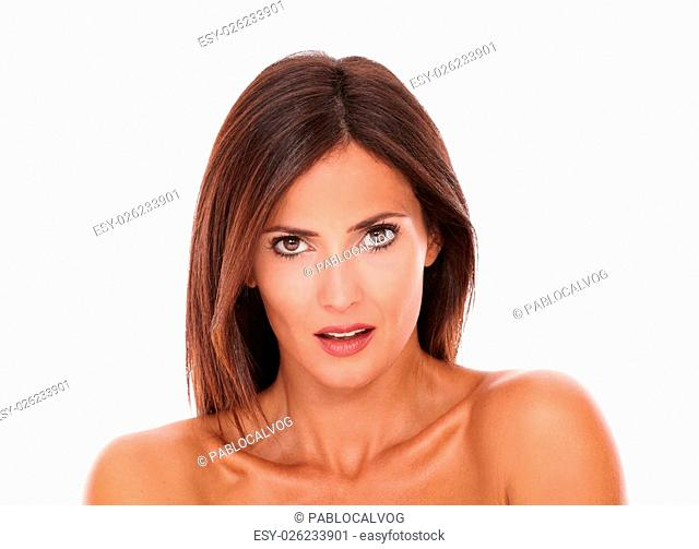 Head and shoulders portrait of adult sexy female showing her beauty with nude shoulders while looking at camera on isolated white background