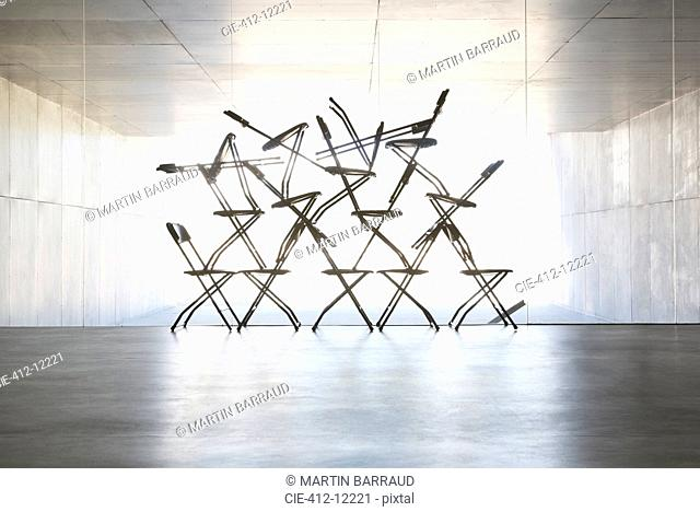 Silhouette of office chair installation art