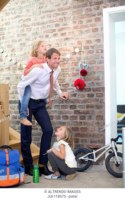 Businessman Father Plays With Children Before Going To Work