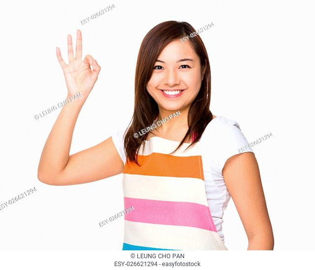 Young Housewife with ok sign gesture