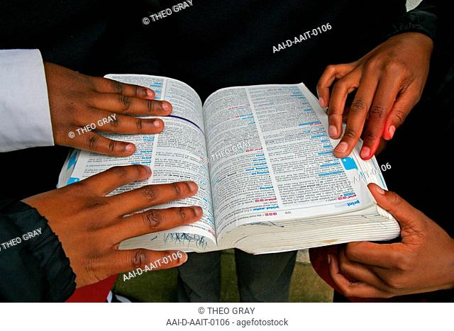 School children holding dictionary, St Mark's School, Mbabane, Hhohho, Kingdom of Swaziland