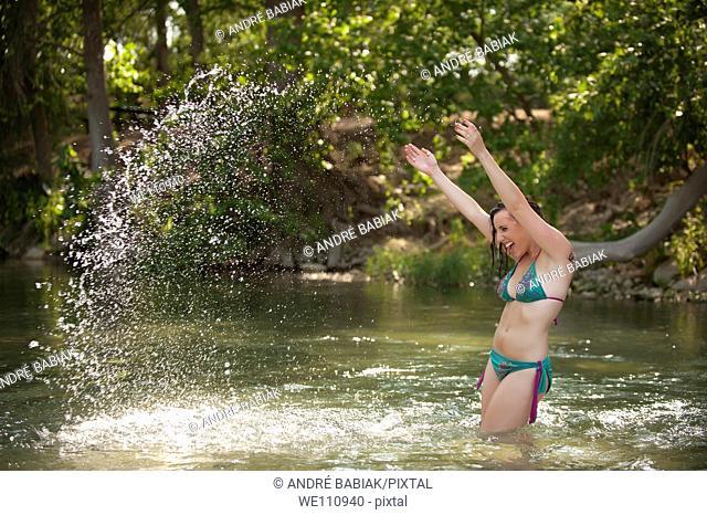 Bikini girl posing at a river