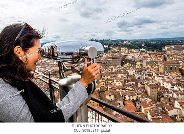 Woman enjoying view from top of Dome Church, Florence, Tuscany, Italy