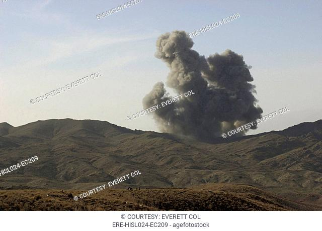 An enemy position in Afghanistan's Gardez Valley is destroyed by smart bombs dropped by B-52 bombers attacking al-Qaeda and Taliban forces. Mar