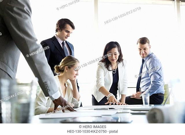 Business colleagues in discussion at conference table