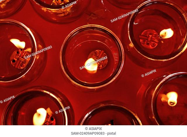 Close up of candles at temple altar