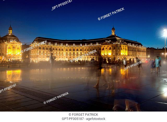 THE REFLECTING POOL AT NIGHT WITH THE TRAMWAY, PLACE DE LA BOURSE, MARECHAL LYAUTEY QUAY, CITY OF BORDEAUX, GIRONDE (33), FRANCE