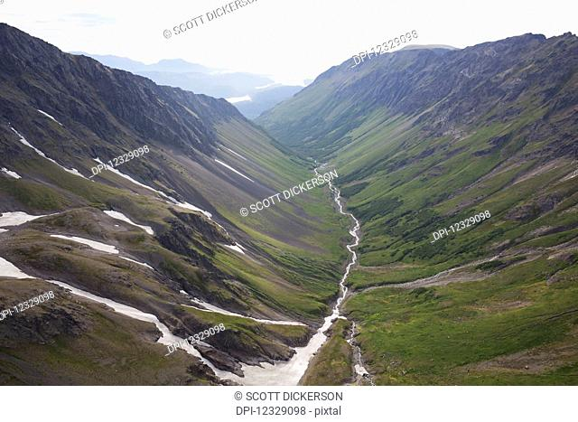 A River Running Through A Valley In The Kenai Mountains, Kachemak Bay State Park; Alaska, United States Of America