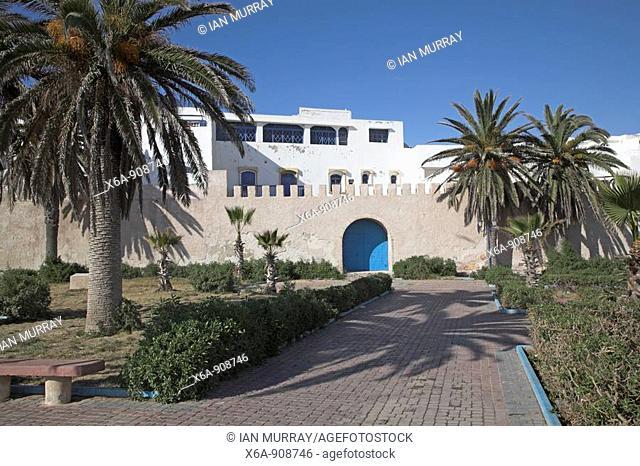Palm trees and garden outside medina walls, Essaouira, Morocco