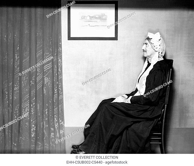On his rocker, instead of off, is Groucho Marx posing as Whistler's Mother. 1960. (CSU-2015-11-1482)