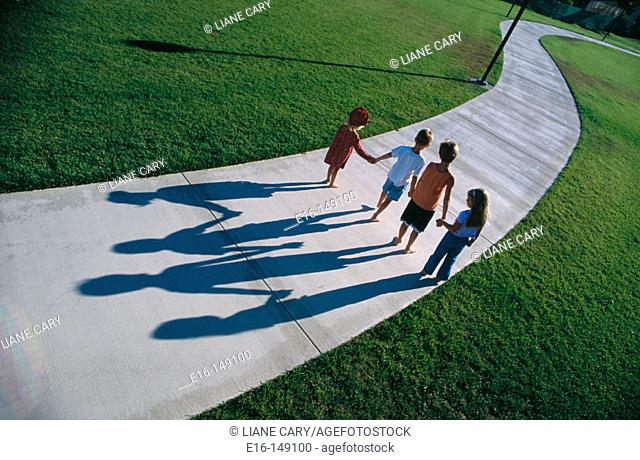 Children walking down path together