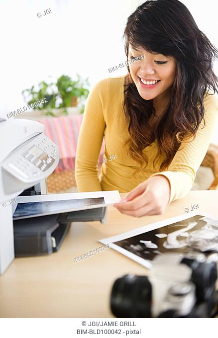 Pacific Islander making photocopies
