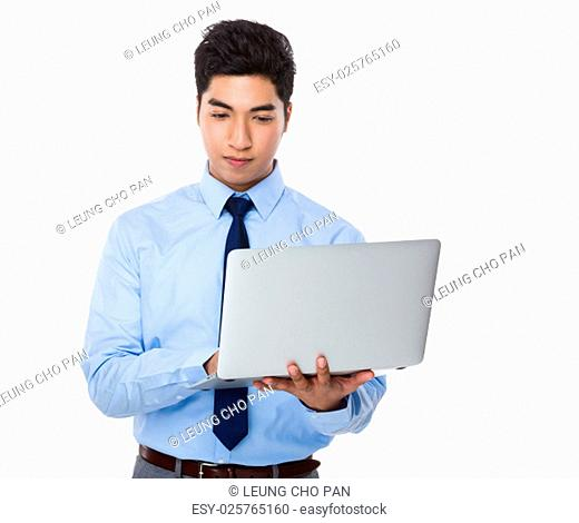 Asian businessman use of the laptop computer