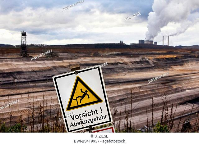 warning sign in front of brown coal surface mining Inden, Germany, North Rhine-Westphalia, Inden
