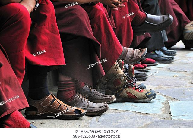 Monks shoos while they are looking at the practice of the Musk dance. Jammu and Kashmir, India