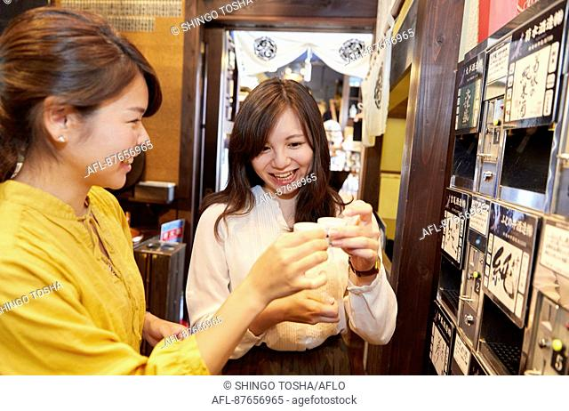 Japanese women enjoying sake tasting