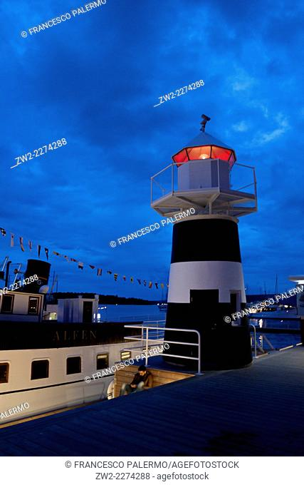 Lighthouse and mystic dusk in harbor. Oslo, Ostlandet. Norway