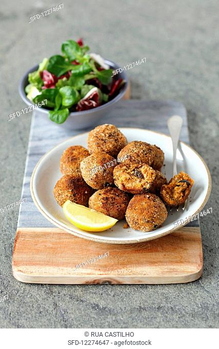 Sprat and potato cakes with black olives