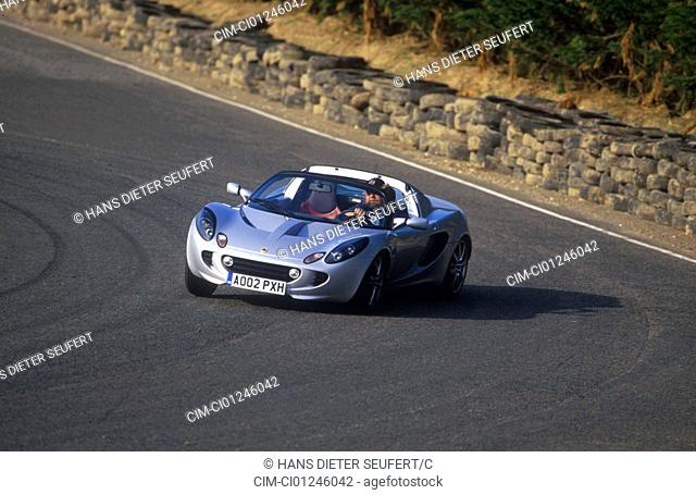 Car, Lotus Elise 111S, Convertible, model year 2002-, silver, open top, driving, country road, diagonal from the front/oben