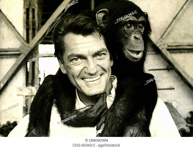 French actor Jean Marais with a chimp