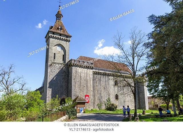 Historic stone church with clock tower at the highest point in Rocamadour, France