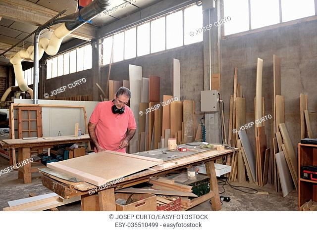 a carpenter working in his workshop
