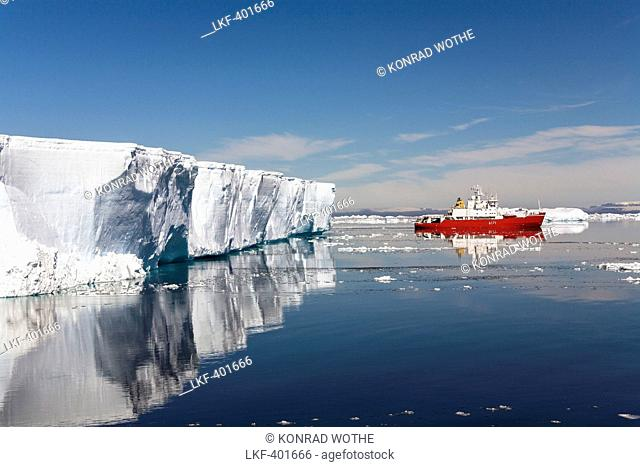 Tabular Iceberg and cruiseship, Weddell Sea, Antarctica