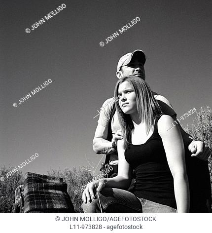 Man and woman with backpack; rural