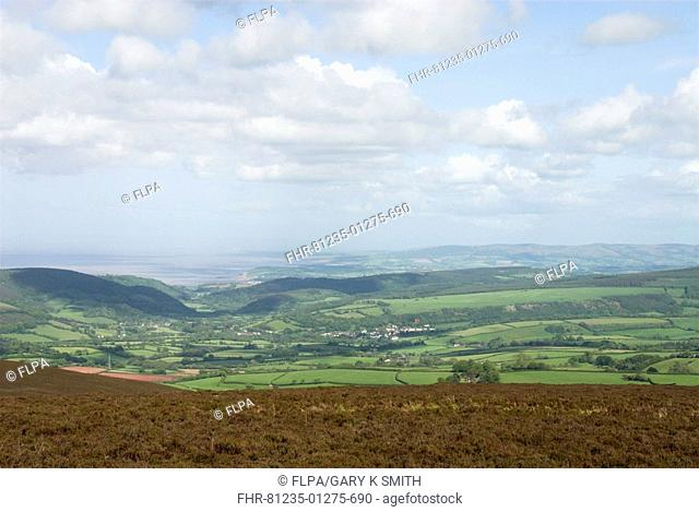 View over moorland towards farmland and village, Exmoor, Somerset, England