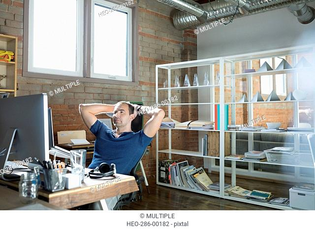 Creative businessman working at computer in office
