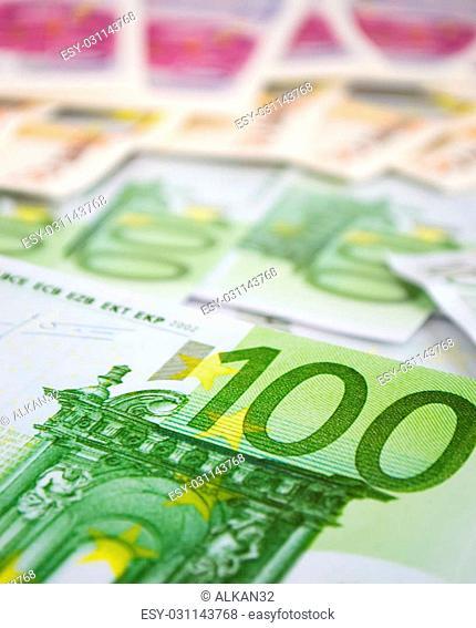 one hundred euro bills close up