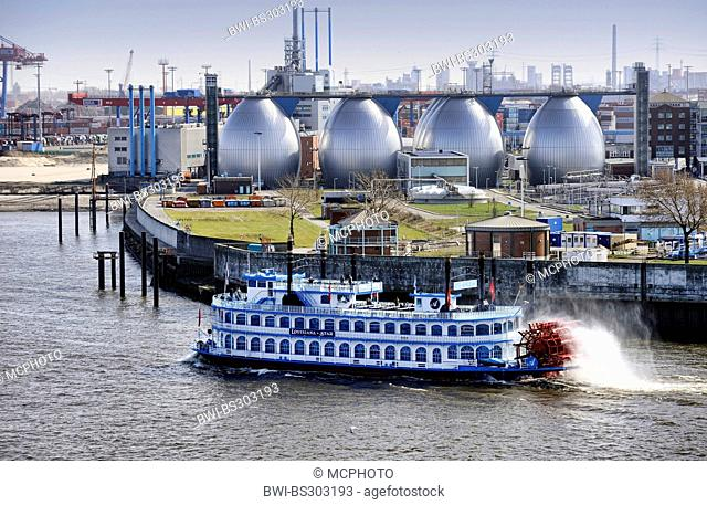 paddle wheeler Louisiana Star and digestion tanks of sewage work Koehlbrandhoeft in Port of Hamburg, Germany, Hamburg