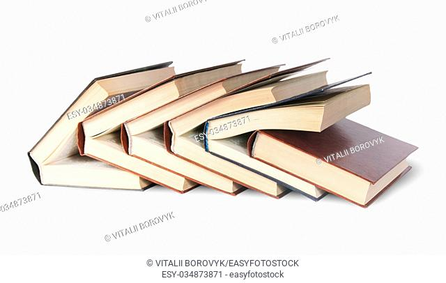 Six old books imbedded in one another front view isolated on white background