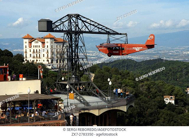 Airplane carousel in Tibidabo Amusement Park, Tibidabo, Barcelona, Spain. The Tibidabo theme park, Barcelona, Spain. Tibidabo is a mountain overlooking...