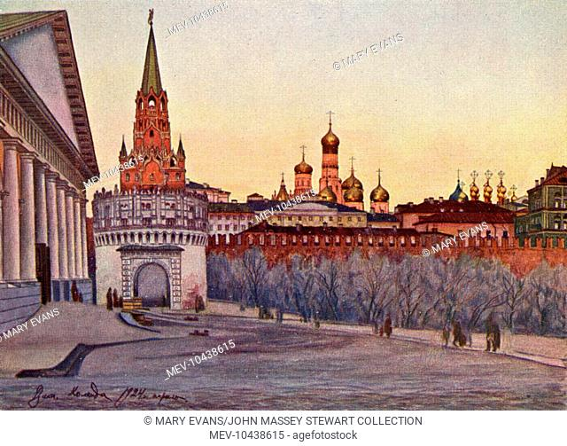 View of the Spasskaya Tower (left) on the eastern wall of the Kremlin complex, Moscow, Russia, at the corner of Mokhovaya Street and Vozdvizhenka Street