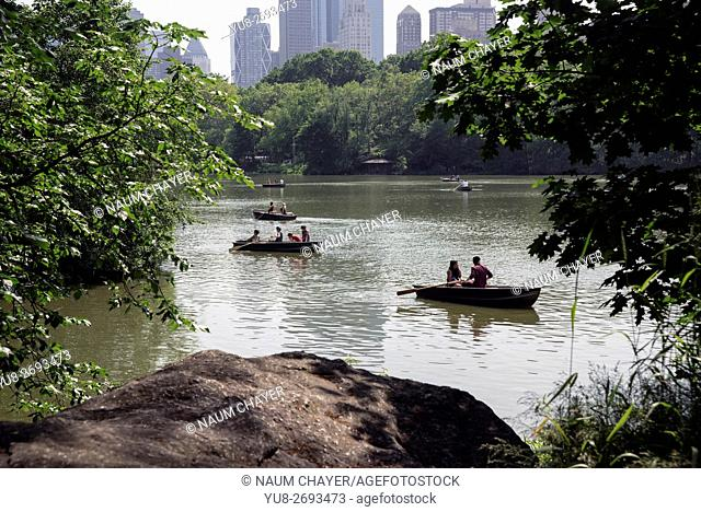 Vacationers and tourists float on boats 20-acre Lake, Central Park's, New York City, USA