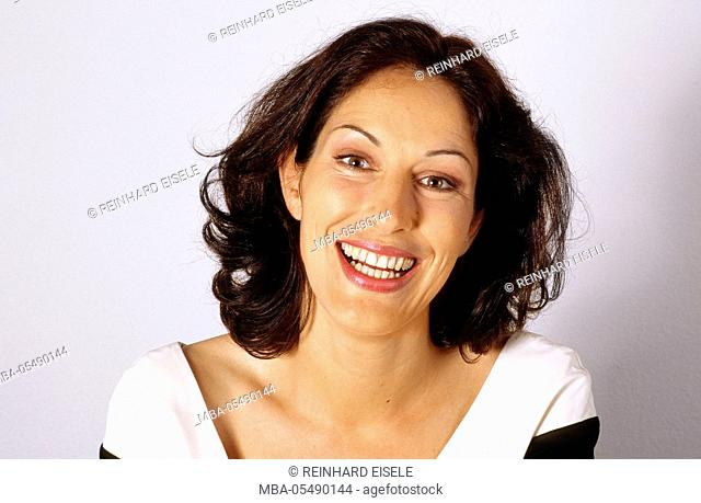 Laughing dark-haired woman