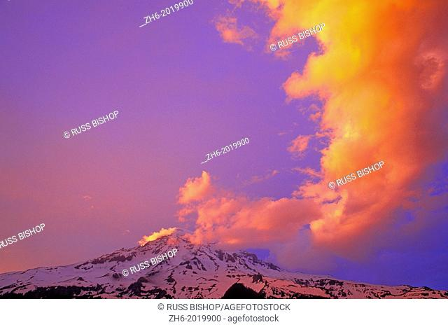 Evening light on vertical cloud formation over Mount Rainier, Mount Rainier National Park, Washington USA