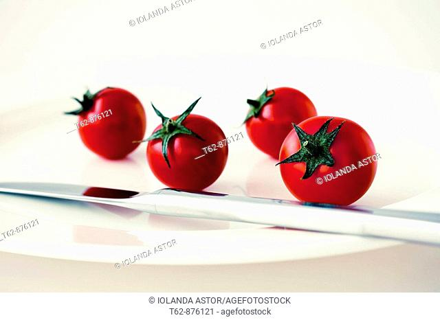 Cherry tomatoes with plate and knife  Still Life  Color