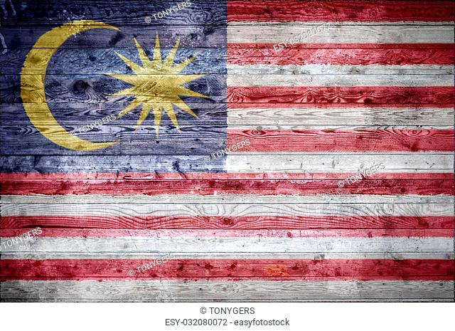 A vignetted background image of the flag of Malaysia painted onto wooden boards of a wall or floor